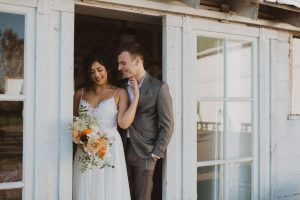 Featuring our Lacy Dress against a rustic wedding venue.