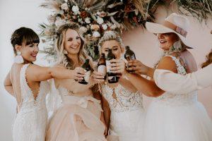 Girls Cheers in Wedding Dresses